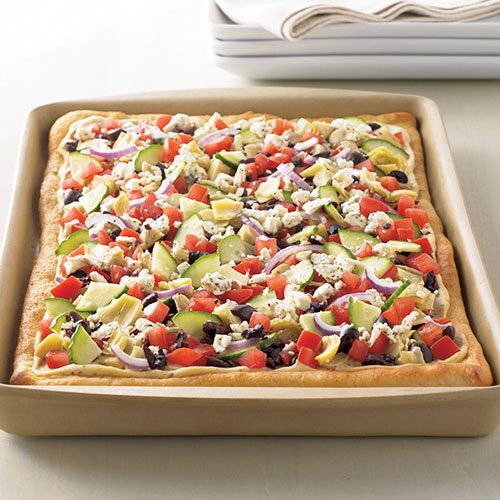 hummus pizza hummus spread and flavorful vegetables top a thin pizza ...